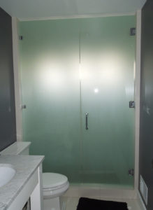sand blasted swinging shower door